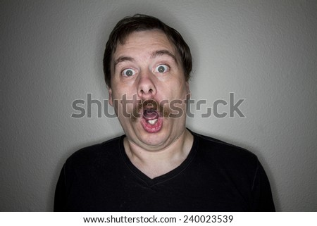 looking shocked with his mouth gaping open  - stock photo