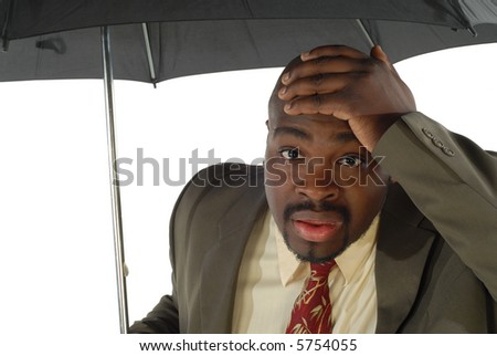 Looking stressed and worried under an umbrella; isolated on white - stock photo