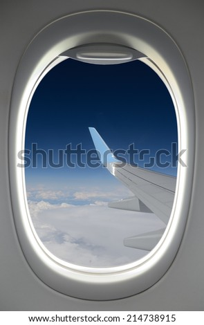 looking through a plane window - stock photo