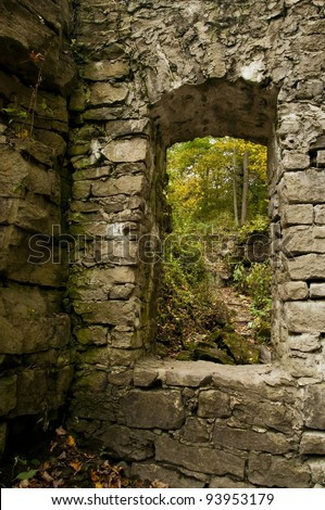 looking through a rough hewn window from turn of the century flour mill - stock photo