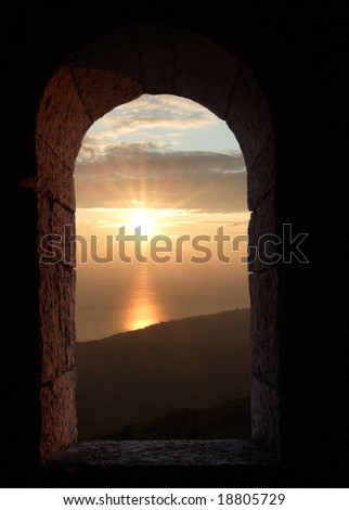 looking through an ancient window with sky