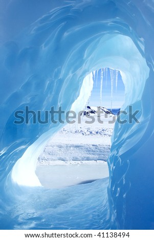 Looking through an ice cave - stock photo