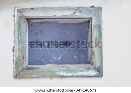 Looking through an old wooden window - stock photo