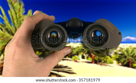 Looking through binoculars in wilderness - stock photo