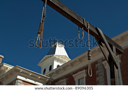 Looking through hanging noose at the county Courthouse, National historical landmark in Tombstone, America's gunfight capital. Arizona, USA - stock photo
