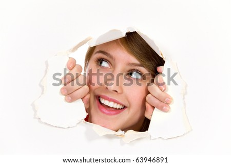 Looking through paper hole - stock photo