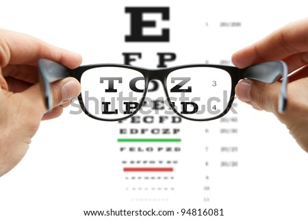 Looking through the glasses at eye chart - stock photo