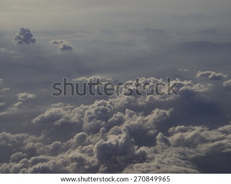 Looking through the window aircraft during the flight - stock photo