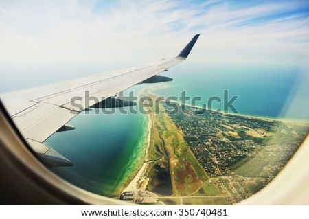 Looking through window aircraft, landing to Copenhagen airport Kastrup. High-angle view from airplane.  - stock photo