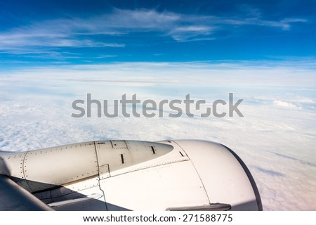 Looking through window airplane during flight in wing - stock photo