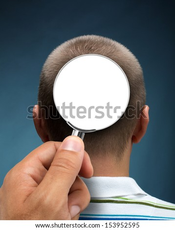 Looking to a head through magnifying glass. Isolated on white - stock photo