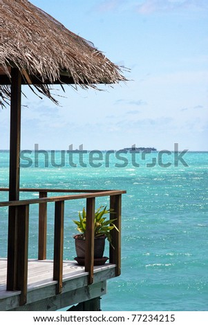 Looking to sea from the balcony of a water villa in the Maldives - stock photo