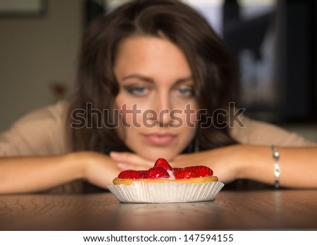 Looking to strawberry cake, focused on it - stock photo