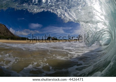 looking toward the shore from a giant wave - stock photo