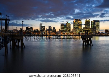 Looking towards Canary Wharf from North Greenwich over river Thames. - stock photo