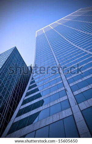 Looking up a curved skyscraper office block in New York City - stock photo