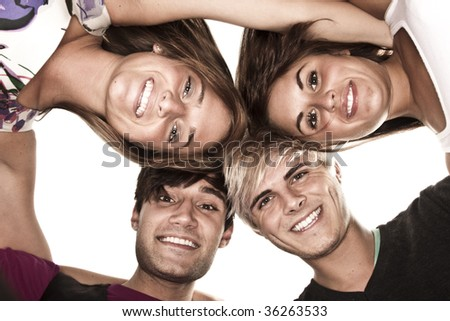 Looking up at a group of great looking young adults - stock photo