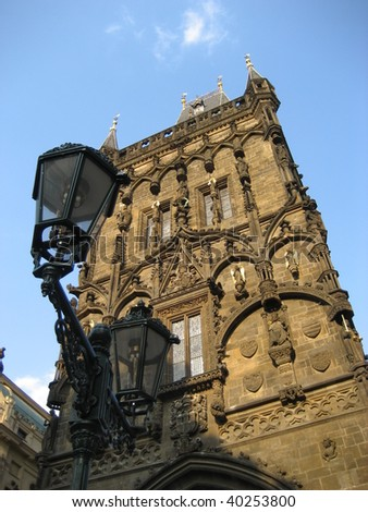 Looking up at a tower on the main square in Prague - stock photo