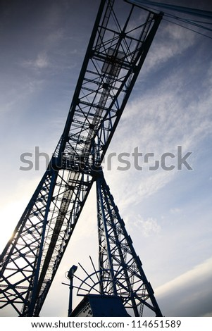 Looking up at a transporter bridge in Middlesbrough Teesside UK - stock photo