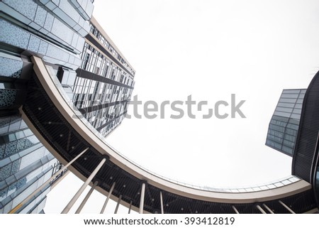 Looking up at business buildings in downtown New York - stock photo
