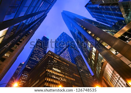 Looking up at Chicago's skyscrapers in financial district at dusk, IL, USA - stock photo
