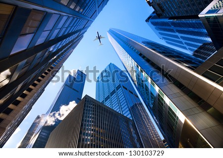 Looking up at Chicago's skyscrapers in financial district, IL, USA - stock photo
