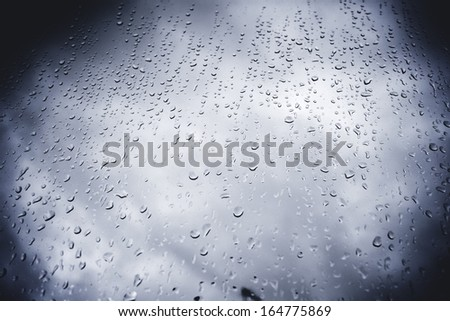 Looking up at droplets on window - stock photo