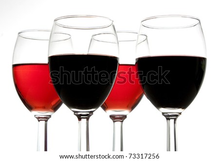 Looking up at 4 glasses of wine - stock photo