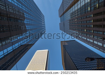 Looking up at office towers in the financial district of Toronto Canada. - stock photo