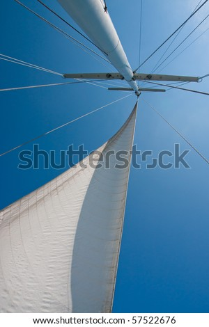 Looking up at sails and mast of boat. - stock photo