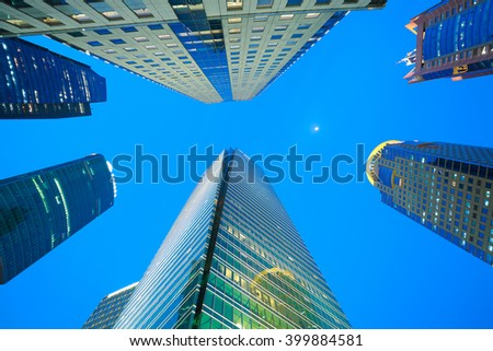 Looking up at Shanghai modern city buildings backgrounds of night scene - stock photo