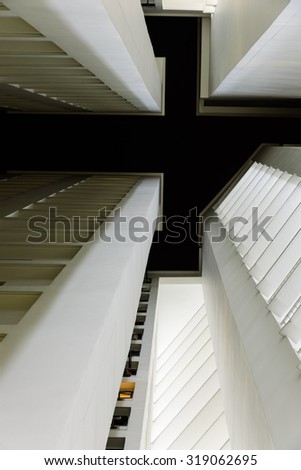 Looking up at Singapore's skyscraper/skylines in Eunos Area at night - stock photo