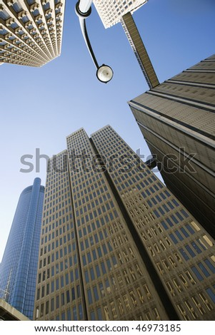 Looking up at skyscrapers in downtown Atlanta with a clear blue sky in the background. Vertical shot. - stock photo