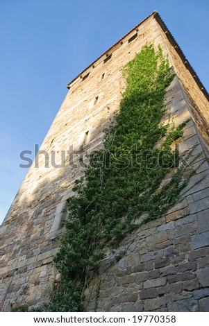Looking up at Stone Tower of Old Castle - stock photo