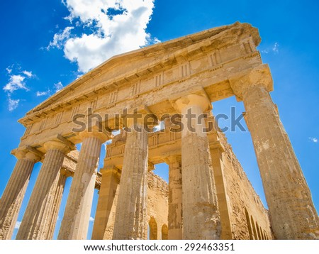 Looking up at the ancient greek temple to Concord in the Valley of Temples in Sicily. - stock photo