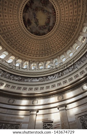 Looking up at the dome inside the United States Capitol building. - stock photo