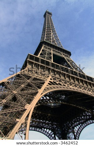 Looking up at the Eiffle tower in Paris, France - stock photo