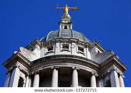 Looking up at the Lady Justice statue ontop of the Old Bailey in London. - stock photo