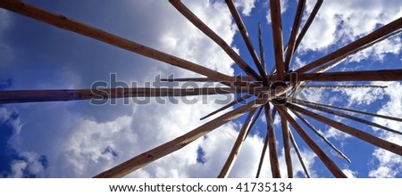Looking up at the lodge pole frame of a Tepee, an American Indian Lodge. - stock photo