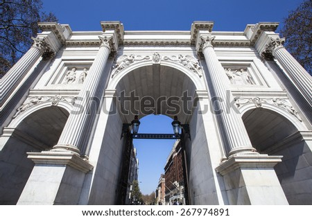 Looking up at the magnificent Marble Arch in London. - stock photo