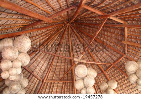Looking up at the thatch roof of a cottage.