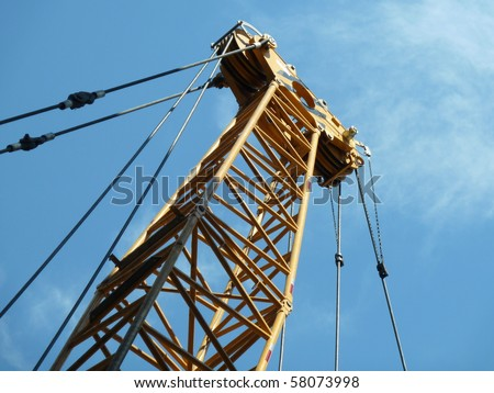 looking up at top of a crane - stock photo