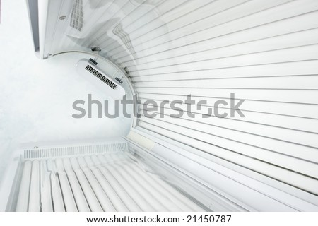 Looking up from inside a modern tanning bed. - stock photo
