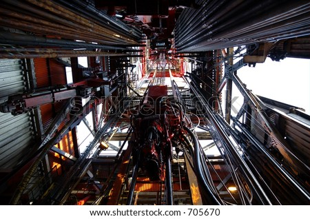 Looking up inside the derrick on an offshore oil rig - stock photo