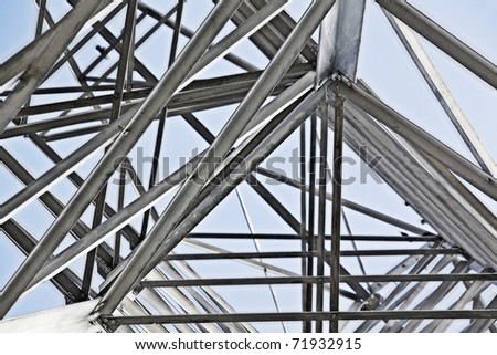 looking up into electrical tower - stock photo