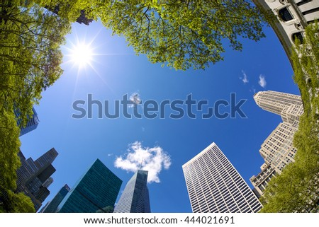 Looking up Midtown Manhattan highrise buildings, Bryant Park, New York - stock photo