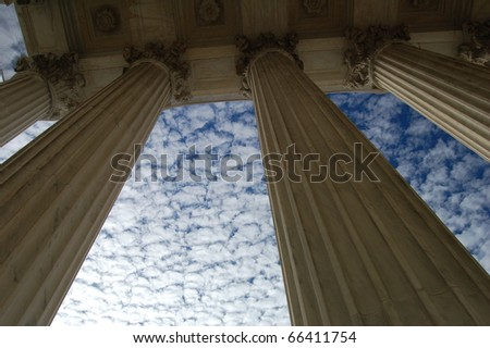 Looking up - pillars in front of the U.S. Supreme Court in Washington D.C./Pillars - stock photo