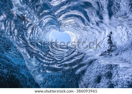 Looking up through a opening in a glacier cave in Iceland  - stock photo