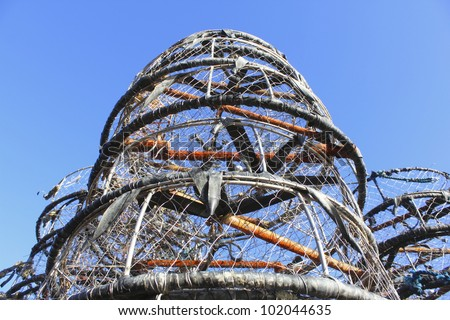 Looking up to a stack of crab nets stacked one on top of the other/Crab Nets/A pile of crab nets - stock photo