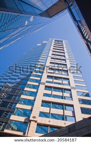 Looking up to the sky surrounded by skyscrapers and office buildings - stock photo